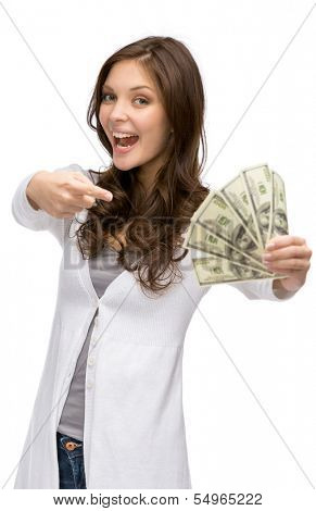 Half-length portrait of happy woman handing money, isolated on white. Concept of wealth and income