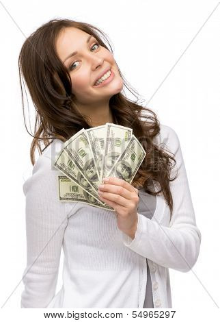 Half-length portrait of happy woman handing cash, isolated on white. Concept of wealth and income