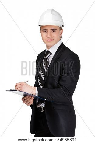 Male builder in white headpiece with papers, isolated on white
