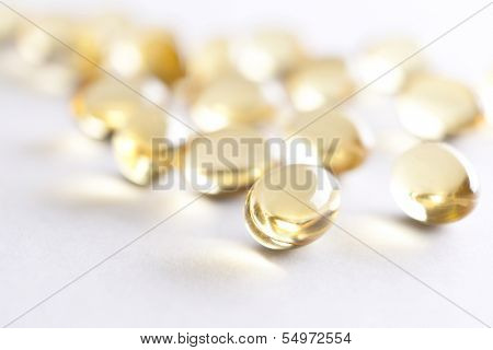 Close up of transparent capsules, isolated on white. Concept of health care, medicine and quick recovery