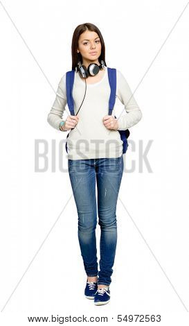 Full-length portrait of teenager with rucksack and earphones, isolated on white