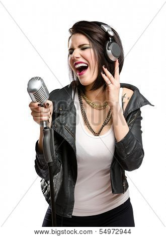 Half-length portrait of rock singer with earphones wearing leather jacket and keeping static mic, isolated on white. Concept of rock music and rave
