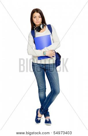 Full-length portrait of teenager with folder, rucksack and earphones, isolated on white