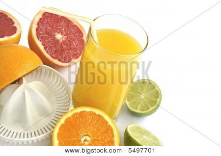 Juicer With Slices Of Citruses And Glass Of Fresh Orange Juice.