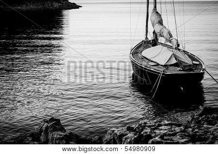 Sailing Boat Moored At Land