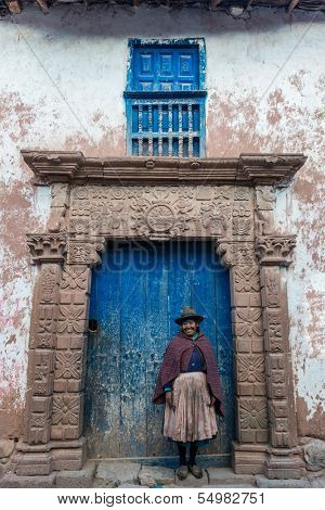 MORAY, PERU - JULY 15: woman in front of ancient door in the peruvian Andes at Moray in Cuzco Peru on july 15, 2013. Moray is located approximately 50km NW of Cuzco on a high plateau at about 3500masl