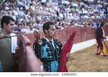 Bullfighter Luis Bolivar picking up the sword to kill the bull in the Bullring of Baeza