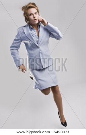 Beautiful Businesswoman Running With Mobile Phone