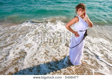 Beautiful Girl Standing On Sea Background