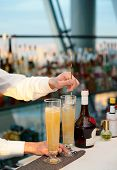stock photo of bartender  - Bartender is stirring a cocktail - JPG