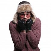 foto of scared  - young man dressed in winter clothes and warm fur hat is  scared about the cold of winter on white background - JPG