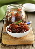 stock photo of red shallot  - red onion marmalade with thyme French cuisine - JPG