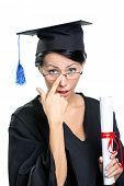 image of school-leaver  - Graduating student in glasses with the diploma adjusts the spectacles - JPG