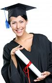 stock photo of school-leaver  - Graduating student in academic black gown and square cap with the certificate - JPG