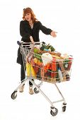 stock photo of grocery cart  - Woman with shopping cart full with dairy grocery products isolated over white background - JPG