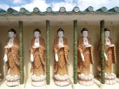 picture of swastika  - Five Buddha images with swastika at the Kek Lok Si temple in the hills above Georgetown Penang Malaysia - JPG