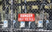 image of substation  - A red sign reading DANGER HIGH VOLTAGE at an electrical substation - JPG