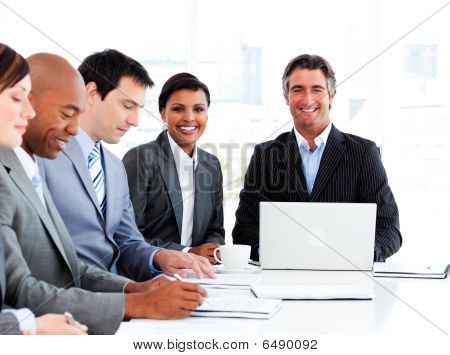 Manager Usimg A Laptop In A Meeting With His Team