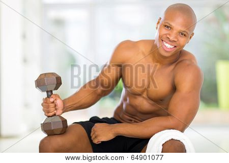 cheerful african man exercising at home