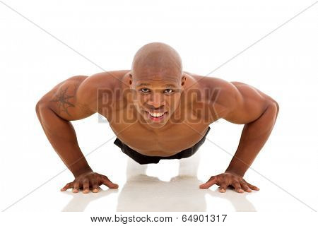 fit young African man doing pushups on floor