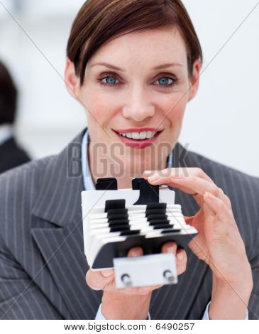 Portrait Of A Young Businesswoman Consulting Her Business Card Holder