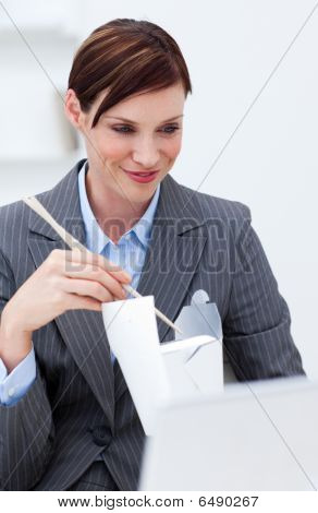 Businesswoman Eating Chinese Food With Chopstick