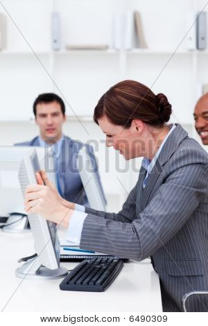 Businesswoman Getting Frustrated With A Computer