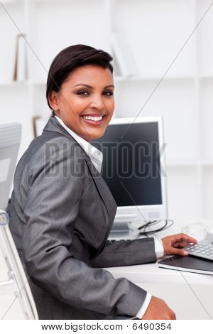 Attractive Female Executive Working At A Compute