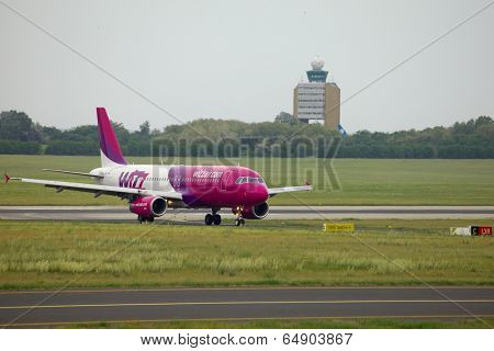 BUDAPEST, HUNGARY - MAY 5: Wizzair A320 taxiing at Budapest Liszt Ferenc Airport, May 5th 2014. Budapest is one of Wizzair's most important bases.