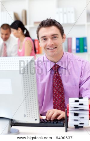 Portrait Of A Confident Businessman Working At His Computer