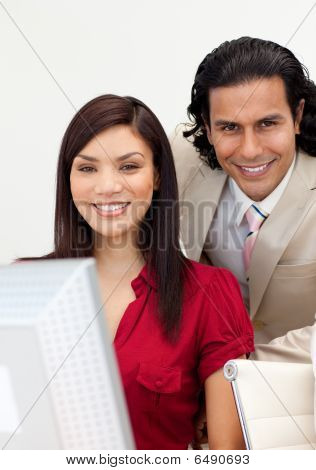Man And Woman Working Together Smiling At The Camera