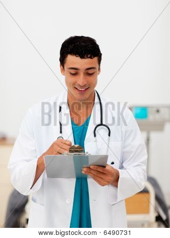 Young Male Doctor Holding A Clip Board