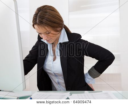 Businesswoman With Back Pain