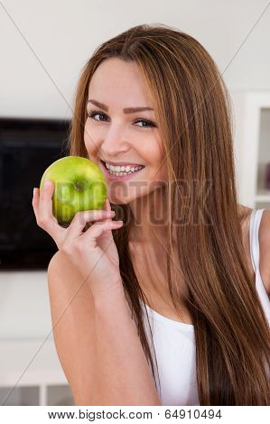 Portrait Of Happy Young Woman Holding Green Apple