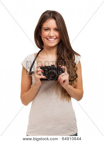 Smiling woman using her camera