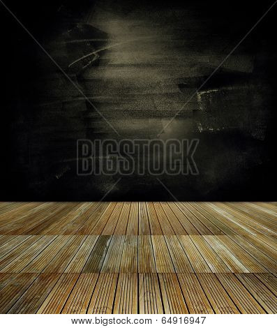 Wooden floorboards and dark wall