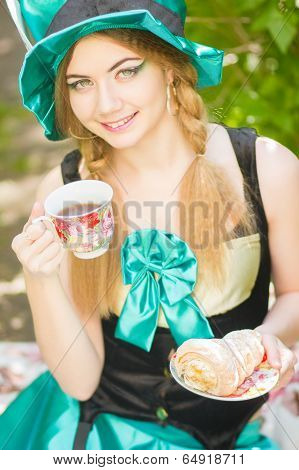 Portrait of a beautiful young woman in a suit mad Hatter in nature