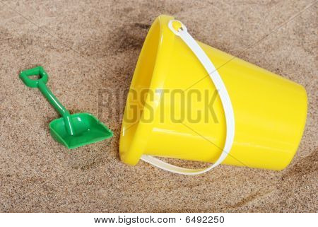 Yellow Childs Pail In The Sand
