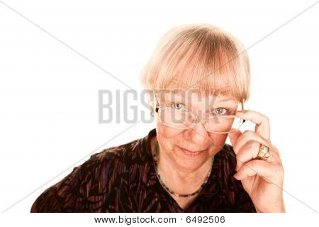 Senior Woman Looking Over Her Glasses