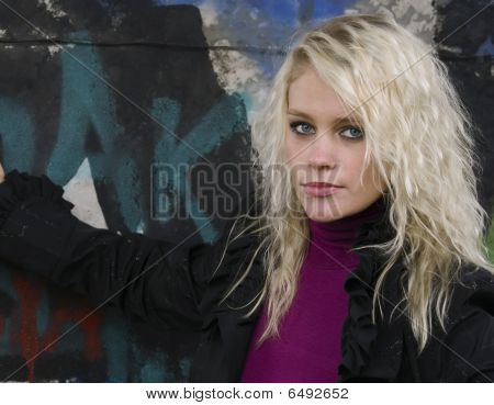 Beautiful Woman At The Stone Wall