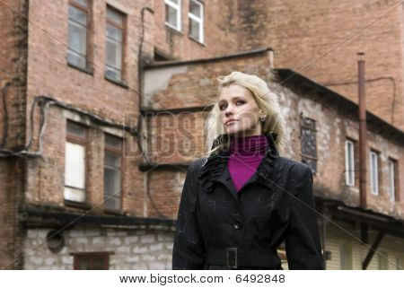 Portrait Of The Attractive Girl On A City Landscape Background