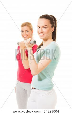 Young women working out with dumbbells