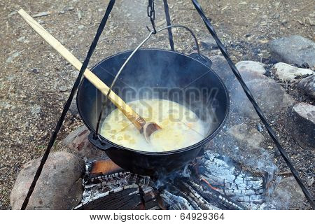 Black Pot On Camp Fire