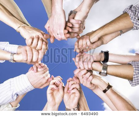 Clasped Hands In A Circle