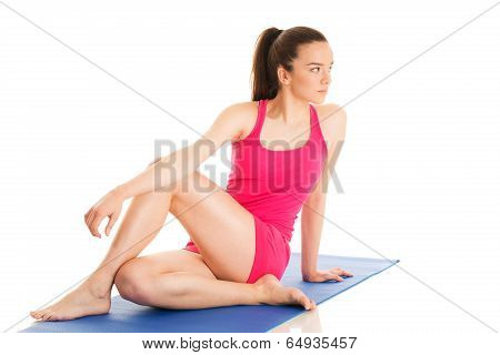 Young woman is exercising yoga