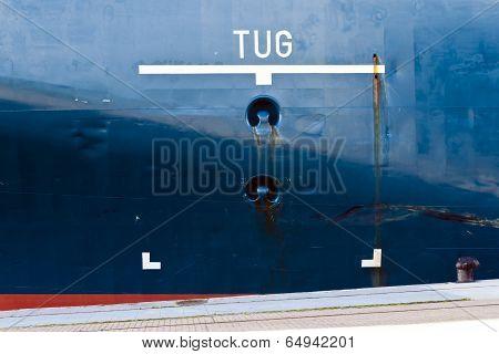 Tug Area Sign On Ship Hull.