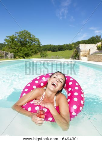 Laughing Woman In Pool With Beverage