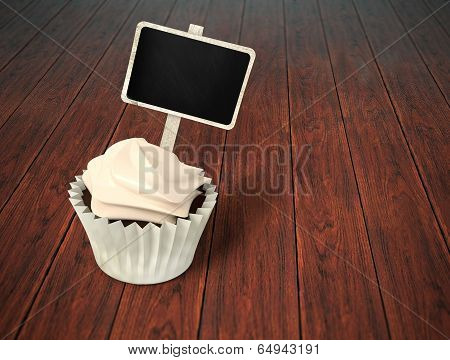 Gift Cupcake With Blank Chalkboard Signboard Label On Dark Wood