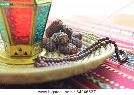 Close up of an arabic dates, lantern and rosary