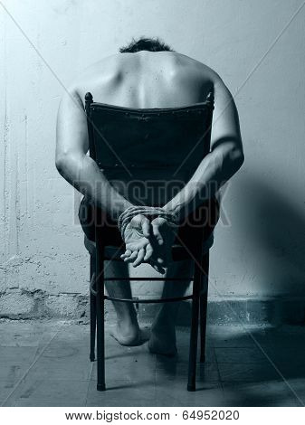 Tortured Man In A Chair With Cold Tones